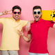 Portrait of a cool gay male couple showing peace gesture - PhotoDune Item for Sale