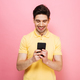 Portrait of a happy young man using mobile phone - PhotoDune Item for Sale