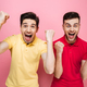 Portrait of an excited gay couple celebrating success - PhotoDune Item for Sale