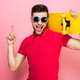 Portrait of a cheerful young man in sunglasses - PhotoDune Item for Sale