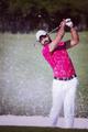 golfer hitting a sand bunker shot - PhotoDune Item for Sale