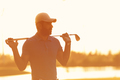 golfer  portrait at golf course on sunset - PhotoDune Item for Sale