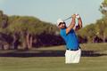 pro golfer hitting a sand bunker shot - PhotoDune Item for Sale