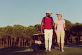 couple walking on golf course - PhotoDune Item for Sale