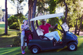 couple in buggy on golf course - PhotoDune Item for Sale