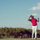 golf player hitting long shot - PhotoDune Item for Sale