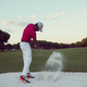 golfer hitting a sand bunker shot on sunset - PhotoDune Item for Sale