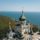 Orthodox Church on a Steep Cliff. Sea and Mountains on a Background. Aerial View of Foros Church on - VideoHive Item for Sale