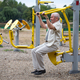 Old man making exercises on outdoor gym. - PhotoDune Item for Sale