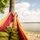 Relaxing in the hammock at the beach under trees, summer day - PhotoDune Item for Sale