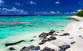 Amazing beach with white sand and black rocks on Rarotonga, Cook - PhotoDune Item for Sale