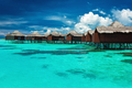 Over water bungalows with steps into lagoon with coral - PhotoDune Item for Sale