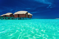 Over water bungalows with steps into lagoon - PhotoDune Item for Sale