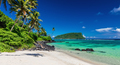 Vibrant tropical Lalomanu beach on Samoa Island with coconut pal - PhotoDune Item for Sale
