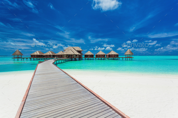 Overwater villas on the tropical lagoon, Maldives - Stock Photo - Images