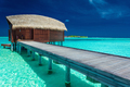Over water bungalows with steps into coral lagoon, Maldives - PhotoDune Item for Sale