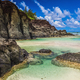 Black Rock, tropical beach surrounded by black rocks, Rarotonga, - PhotoDune Item for Sale