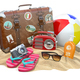 Beach accessories for relaxing. Sunscreen bottle, flip flops, su - PhotoDune Item for Sale