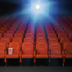 Cinema and movie theater concept background. Empty rows of red s - PhotoDune Item for Sale