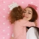 Mother and Daughter Embrace and Blow Party Horns, Smiles, Have Fun, Laugh and Celebrate - VideoHive Item for Sale