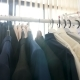 Hangers Full with Different Clothes in a Store Next To a Window - VideoHive Item for Sale