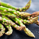 Raw fresh asparagus on dark background, close-up - PhotoDune Item for Sale