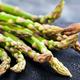 Raw fresh asparagus on dark background, close-up - PhotoDune Item for Sale