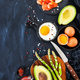 Top view of breakfast table with fried eggs, avocado, asparagus, - PhotoDune Item for Sale