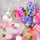 Easter eggs with beautiful hyacinths and willow bouquet on light - PhotoDune Item for Sale