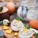 Eggs stuffed with herring creamy pate on wooden rustic backgroun - PhotoDune Item for Sale