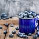 Fresh ripe blueberries and in blue enamel mug - PhotoDune Item for Sale