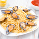 Italian pasta with Galician mussels in white wood, approach - PhotoDune Item for Sale