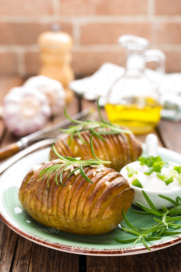 Baked potato. Potato oven baked with garlic and rosemary - Stock Photo - Images