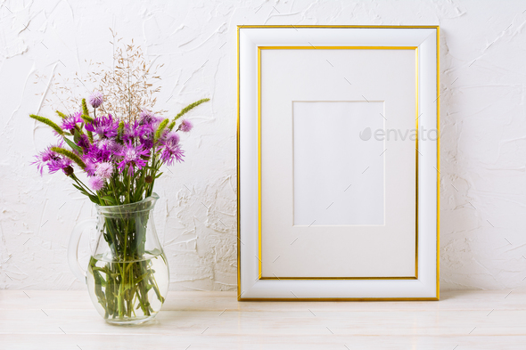 1ca130d29d3f Gold decorated frame mockup with purple burdocks in glass - Stock Photo -  Images