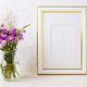 Gold decorated frame mockup with purple burdocks in glass - PhotoDune Item for Sale