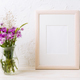 Wooden frame mockup with purple burdocks in jug - PhotoDune Item for Sale