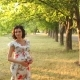 Happy Pregnant Girl in the Park at Sunset - VideoHive Item for Sale