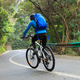 Riding mountain bike descent slope on road - PhotoDune Item for Sale