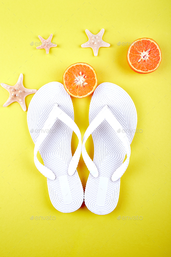 White Flip flops, Orange fruit, starfish - Stock Photo - Images