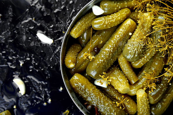Canned cucumbers in a metal pan. - Stock Photo - Images