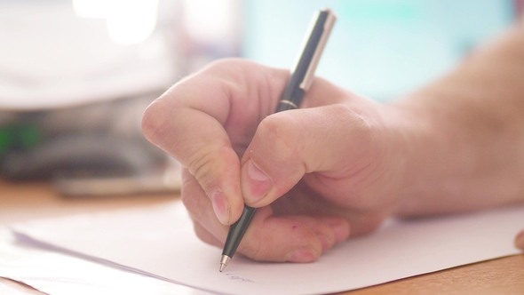 A man writing with a pen by hand on the paper hand blurred play preview video thecheapjerseys Images