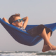 Happy little boy relaxing on the beach at the day time - PhotoDune Item for Sale