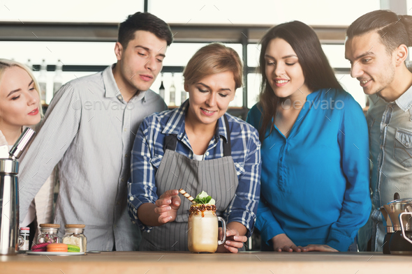 Experienced smiling barista giving master class - Stock Photo - Images