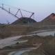 Excavators Load Ore Into Dump-trucks. This Area Has Been Mined for Buaxite, Aluminum and Other - VideoHive Item for Sale