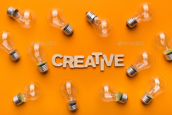 Abstract creative background with light bulbs - Stock Photo - Images