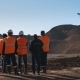 Panorama Shot of a Group of Workers in Overalls Actively Speaking on Board a Bauxite Quarry. - VideoHive Item for Sale