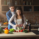 Happy couple cooking healthy food together - PhotoDune Item for Sale