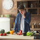 Upset man preparing healthy food in the home kitchen - PhotoDune Item for Sale
