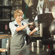Experienced barista making coffee in professional coffee machine - PhotoDune Item for Sale