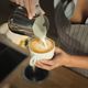 Closeup of barmen pouring milk to cappuccino cup - PhotoDune Item for Sale